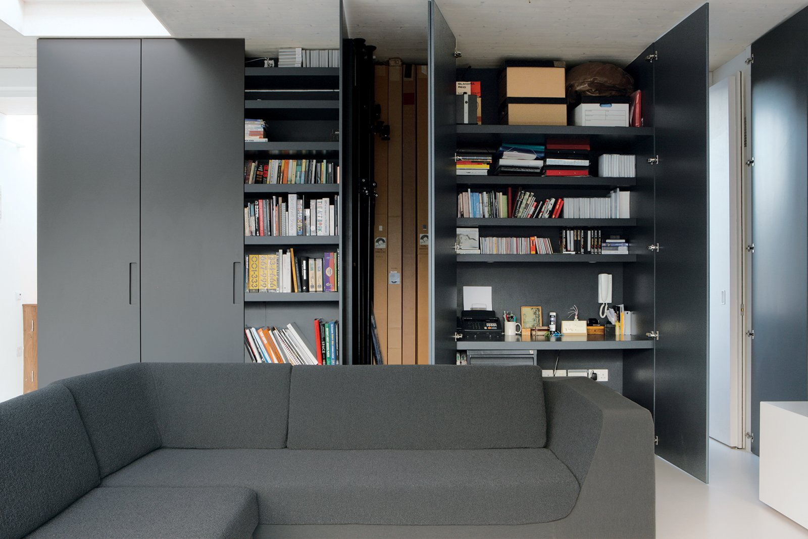 Reeve's partner, Michela Meazza, uses built-in closets for her home office. The imposing gunmetal gray doors can simply be swung shut at the end of a long day's work.
