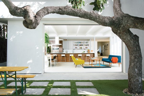 A mature avocado tree shades the hardscaped patio located just outside the great room.
