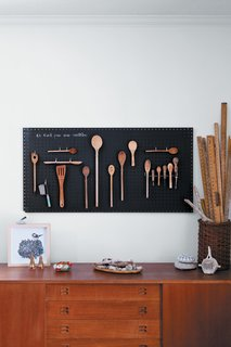 DIY Black Chalkboard Pegboard by Margaret Oomen - Photo 1 of 1 - Margaret Oomen created the perfect pegboard sourcing inspiration—and a can of chalkboard paint—from the aisles of Home Depot.