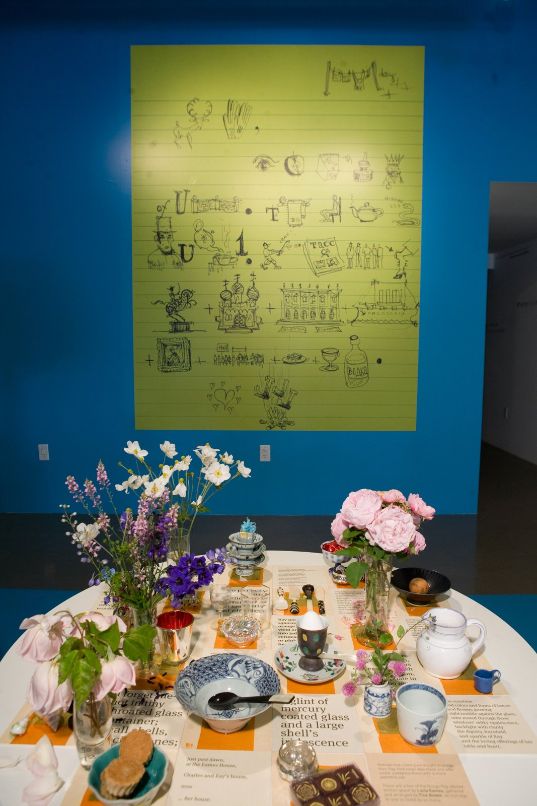 "Charles created this rebus for his daughter, Lucia, when she was a child. ""Some people want a key for it; some don't,"" says Sussman. Ray's table was curated by artist Tina Beebe, who worked closely with Ray in the Eames Office and decorated the surface with the flowers and objects Ray favored.  Photo 13 of 13 in 15 Flower Arrangements That Will Brighten Your Home on Valentine's Day from Ray Eames 101"