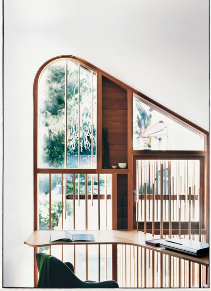 The delicate wooden dowels, used both on the exterior facade and the mezzanine level balustrade, are nods to the bamboo fences traditionally found in tea gardens.