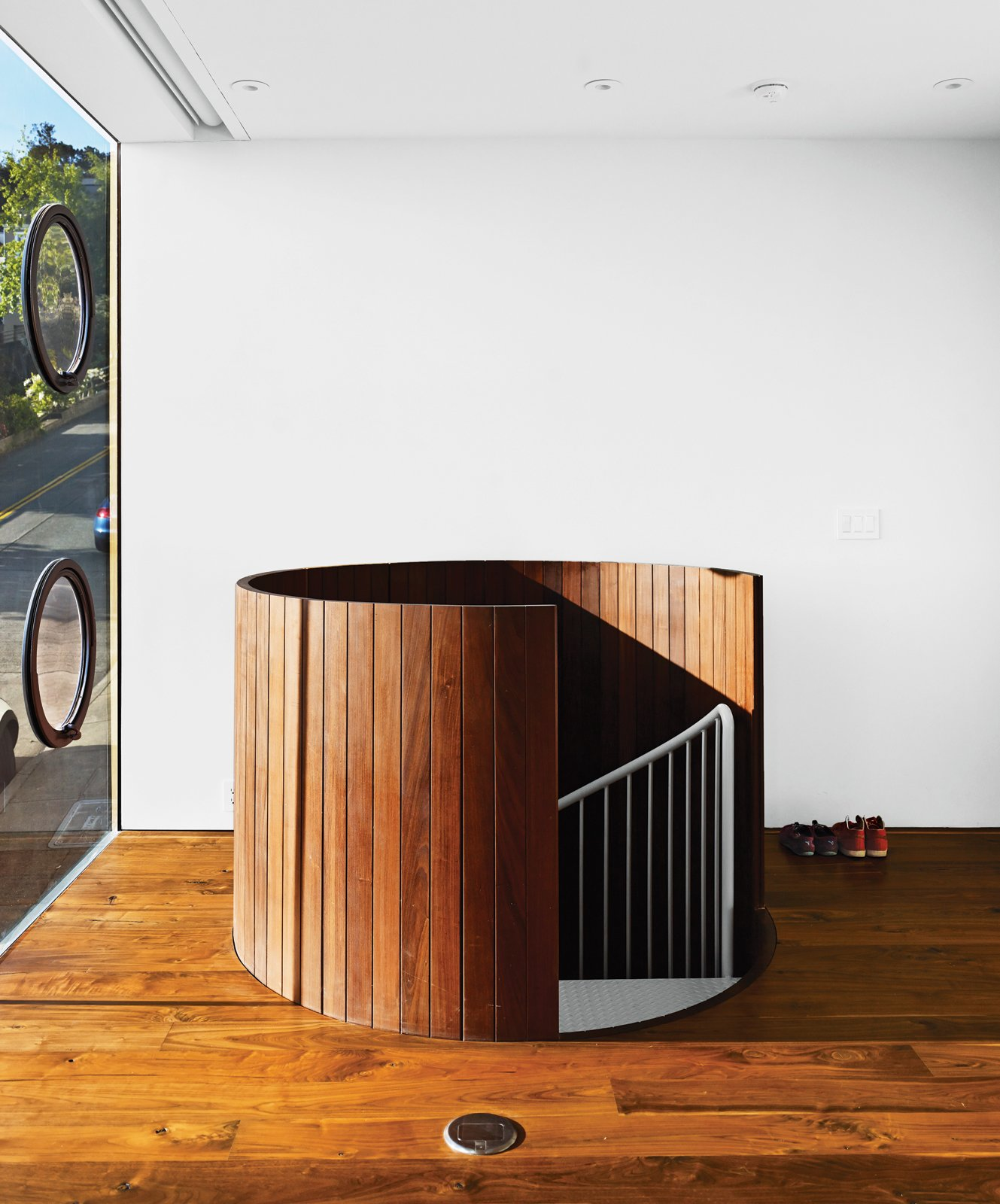 The trip from garage to first floor is through a wood-clad spiral staircase that resembles a giant slatted barrel. Tagged: Staircase, Metal Railing, and Metal Tread.  190+ Best Modern Staircase Ideas by Dwell from Striking Slatted Wood and Glass Home in San Francisco