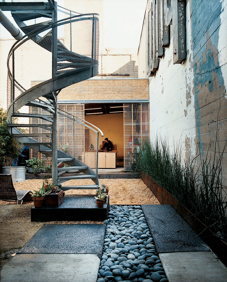 A spiral staircase descends from the glass deck to the rain garden, which replaced a concrete pad. 190+ Best Modern Staircase Ideas by Dwell