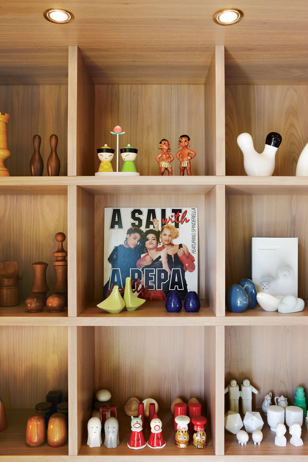 Montague arranges his objects with a sense of humor. Custom shelves display his collection of salt and pepper shakers.