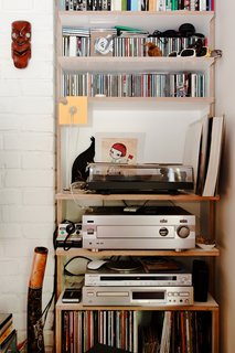 Much of the charm of this small, affordable space is its sense of careful clutter. The stereo, LPs, and CDs only add to the sense that this flat was designed for living, not as some airless showpiece.