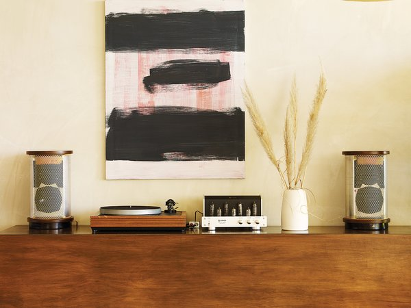 Pearson and Trent designed the sideboard just tall enough so that their young children, Delphine and Chantal, couldn't reach the vintage stereo. Above it is a painting by Los Angeles artist Jon Pestoni.