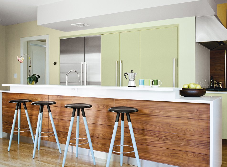 Roynon coated the wooden legs of the Vig bar stools by BoConcept with Atmospheric, a grayish-blue paint from Benjamin Moore, so they would stand out against the island's walnut-veneer base.