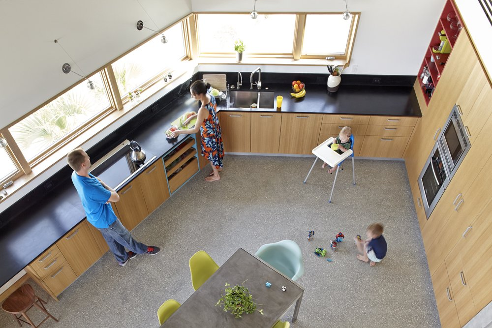 The kitchen from above, looking down from the second floor. Jody Beck with hudband Ross-Alan Tisdale, partners in Traction Architecture, with their kids Robin and Jonah.