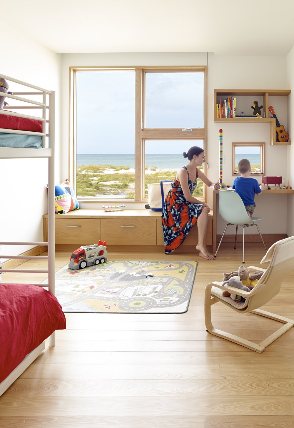 The kids' bedroom sports an Ikea bunk bed and trundle, which leaves plenty of space for toys. Custom cypress built-ins provide multi-functional storage and seating areas and minimize the need for furniture. Angular Modern Beach House in Florida - Photo 7 of 10