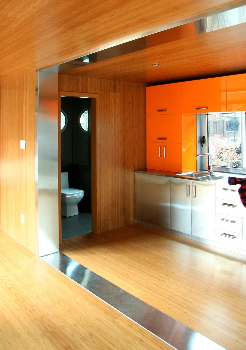 Each unit features a customizable kitchen with IKEA products and a slate bathroom. The interior is lined with bamboo.  Prefab Homes by Dwell from Inexpensive, Easy-Assembly Shipping Container Home