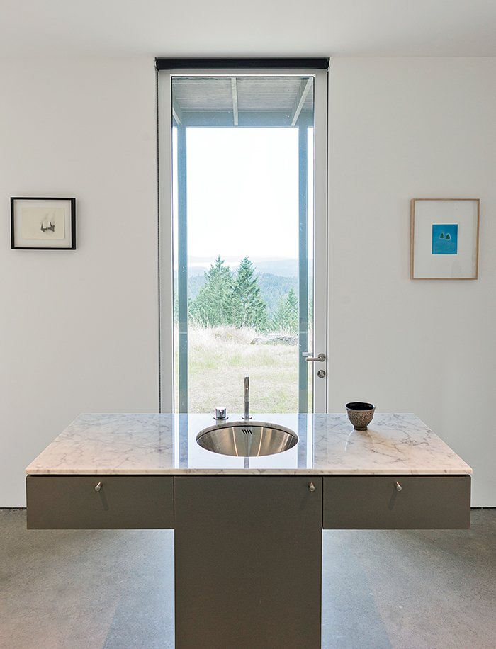 Seattle's Special Projects Division designed the custom cabinetry throughout the house. A Vola faucet is integrated with the Carrara marble vanity. Idyllic Home Designed for an Artist - Photo 6 of 18