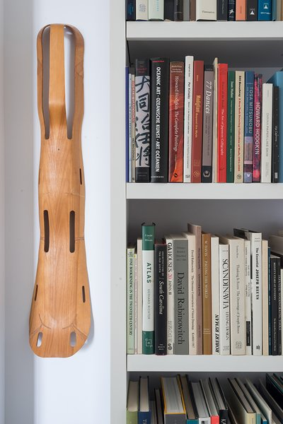 On a wall hangs a leg splint designed by Charles and Ray Eames for the U.S. Navy in 1942.