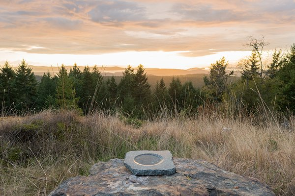 A stone bowl Brothers made in the 1990s is positioned on a rock.
