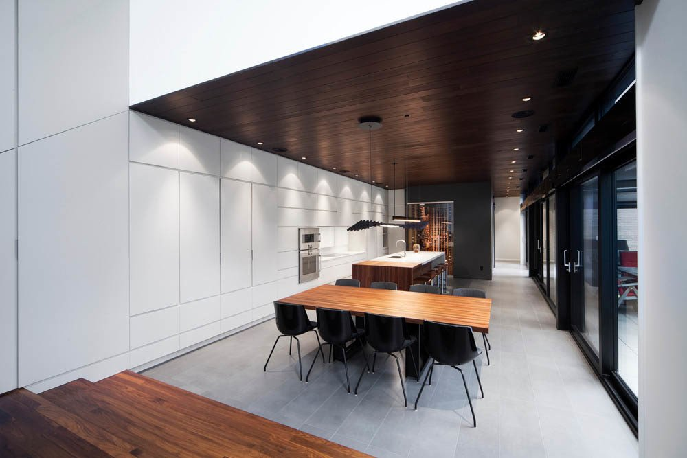 Life ceramic tiles by Ciot were used in the kitchen. The veneer cabinets were made by Bruno Pichet.