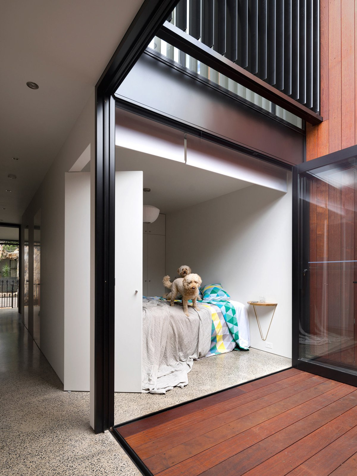 "An internal courtyard anchors the house while ushering in air and light. Its materials echo those used in the rear yard. ""You get a glimpse of both outdoor spaces when walking through the house,"" Abicic says."