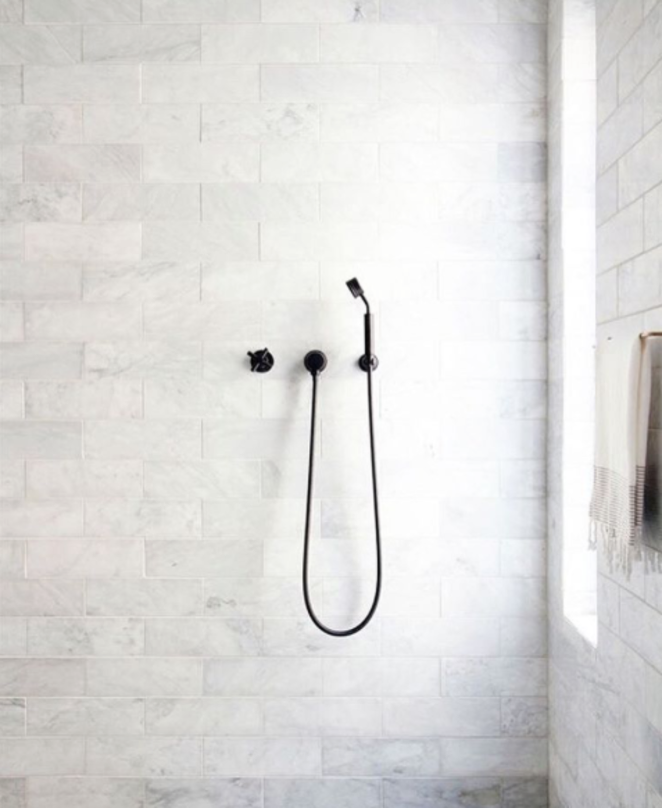 @emilylauren.au posted this pared-down bathroom with monochromatic matte fixtures by Chanee Vijay.  Detail by Rachel Joy Nagy from Spotted on Instagram: Five Totally Different Styles for Your Bathroom