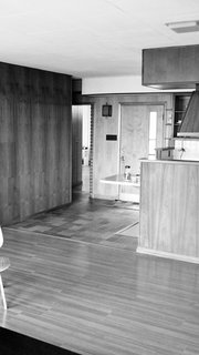 The Midcentury Spirit is Alive and Well in This Hudson Valley Escape - Photo 3 of 11 - The kitchen was formerly closed off and now flows into the living room post renovation.