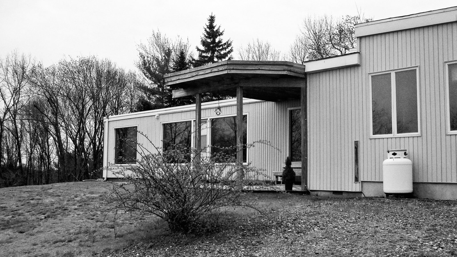 On the house's south side, Jordan excised the covered porch.  Photo 10 of 12 in The Midcentury Spirit is Alive and Well in This Hudson Valley Escape