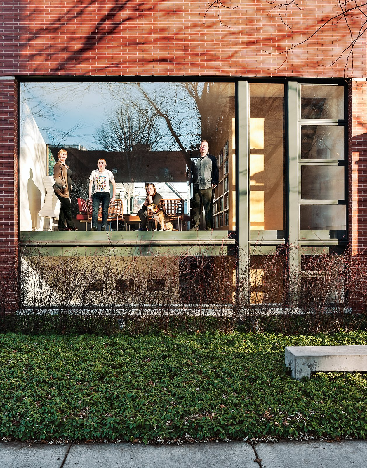 Chicago architect Brad Lynch demolished the 1940s bungalow he'd been sharing with his family for nearly two decades, and in its place built a brick-clad structure that would function as a modern counterpoint to its more traditional neighbors.  Renovations by Aiko Genest from A Brick-Clad Modern Family Home in Chicago