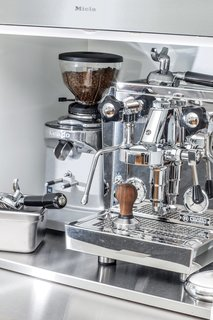 A Sleek Kitchen Renovation in San Francisco - Photo 4 of 5 - The coffee station features a professional-grade Rocket Espresso machine. Jang and King designed a stainless-steel pullout shelf for a cream and sugar station.