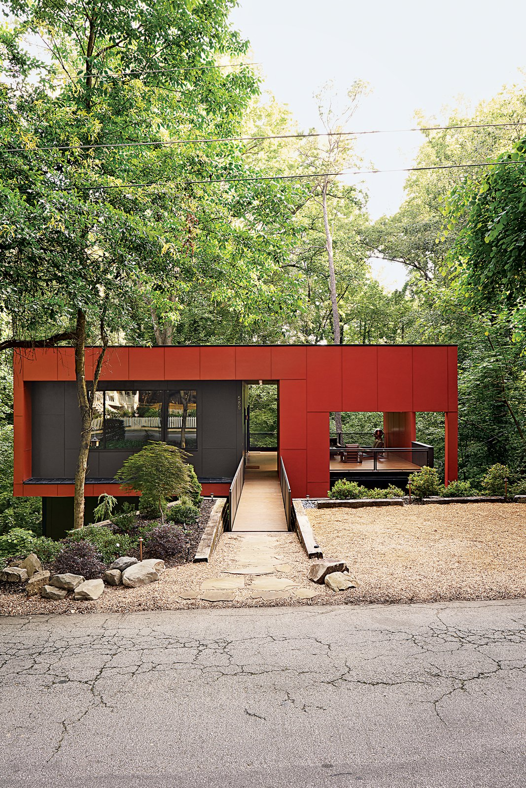 A bridge spans the home's steep site for street access. An Affordable Modern Home in Atlanta - Photo 2 of 2
