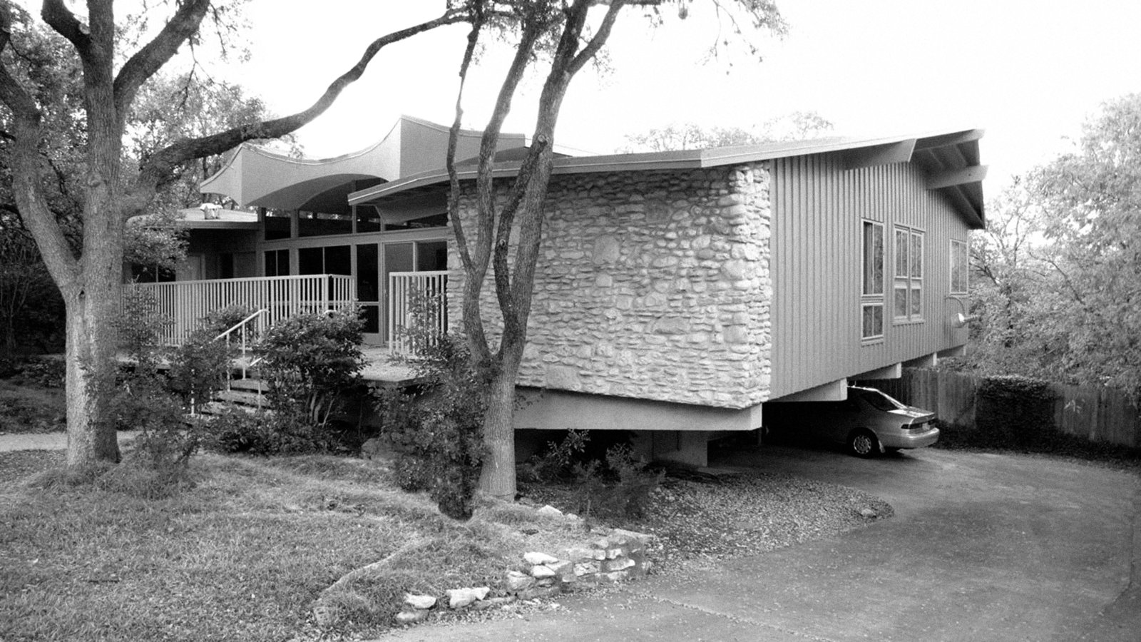 Architect A.D. Stenger designed and developed scores of houses in Austin, Texas, including this one, whose Jetsons-esque facade is rumored to reference the aeronautics classes he took in college.  Mid Century Modern Austin by Creede Fitch from A Renovated Midcentury Gem in Austin