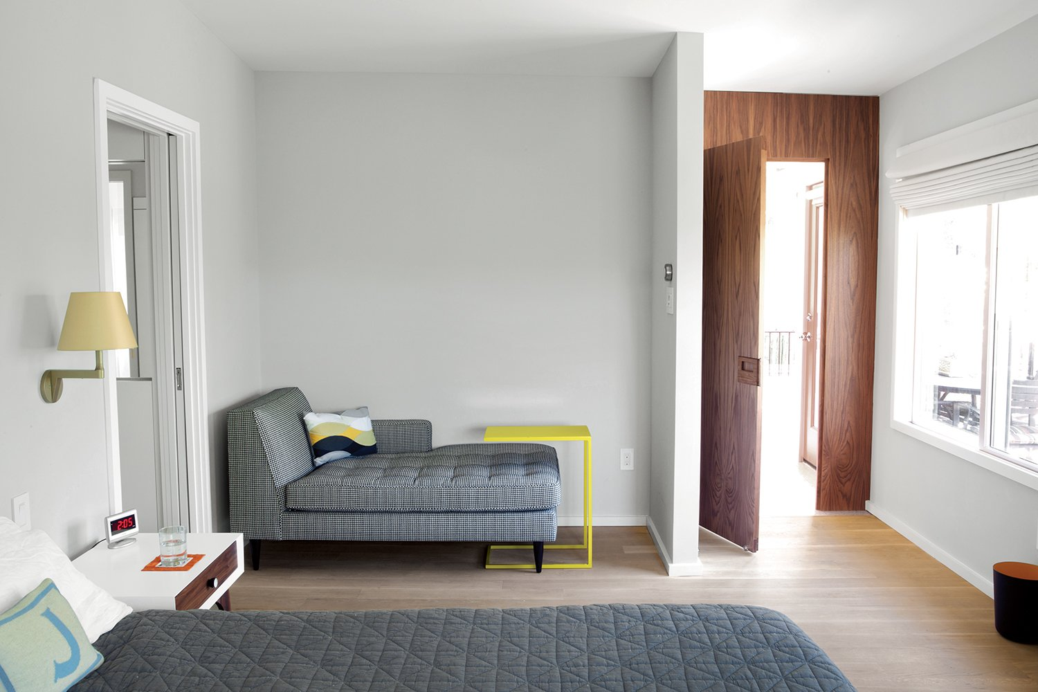 """""""Life happens around architecture. And that's fine: A lot of houses get more beautiful when they age.""""   —Architect Rick Black Tagged: Bedroom and Bed.  Photo 5 of 11 in A Renovated Midcentury Gem in Austin"""