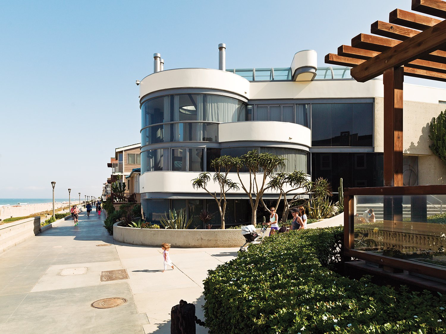 The glass-walled facade faces the Strand.  Imaginative Round Homes by Robert Gordon-Fogelson from A Renovated Ray Kappe Abode in Manhattan Beach
