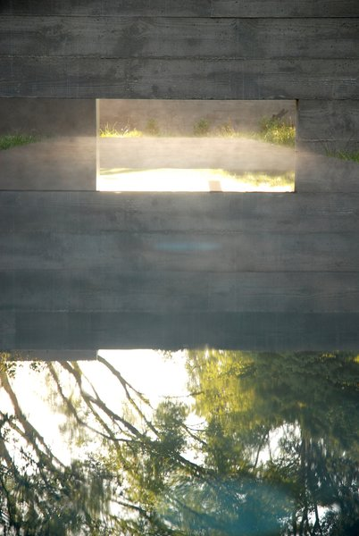 "A reflecting pool for a residence that Aidlin Darling designed in San Joaquin Valley, California. ""This rural residential project incorporates the agricultural vernacular language of California's Central Valley, including irrigation aqueducts and vastness of scale,"" David Darling says. ""Landscape, materiality, and the cooling effect of water elements were paramount."" Photo courtesy of the Sonoma Valley Museum of Art."