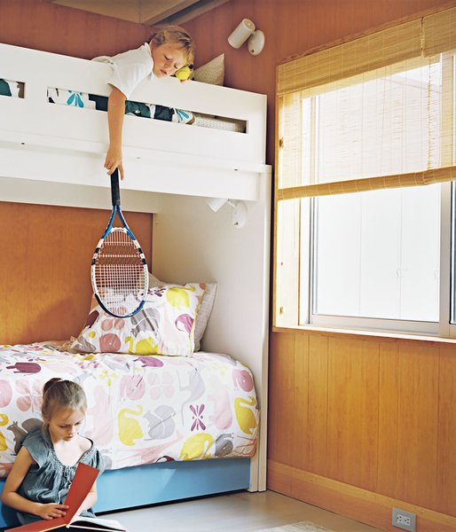 At the Fisher family's 1960s Long Island beach bungalow, the kids share a warm, bright space with modern prints.