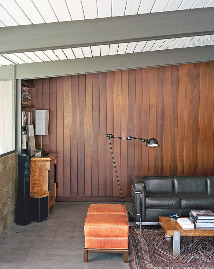 """""""I believe Jones designed these houses to be living things. They're not museums,"""" says architect and resident Bruce Norelius. Tagged: Living Room, Sofa, and Concrete Floor.  Tips for Creating a Comfortable Living Room by Drew McGukin from L.A. Renovation Respects Midcentury Bones (While Adding Some Flair)"""