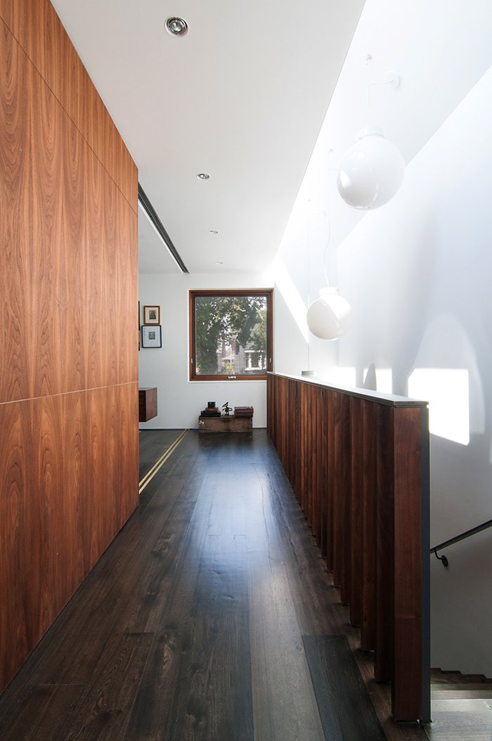 Windows in the roof monitor let in natural light and ventilation. Tagged: Hallway and Dark Hardwood Floor.  Lounge by Jim Tattersall from A Toronto Tudor Becomes Bright, Luxurious Home