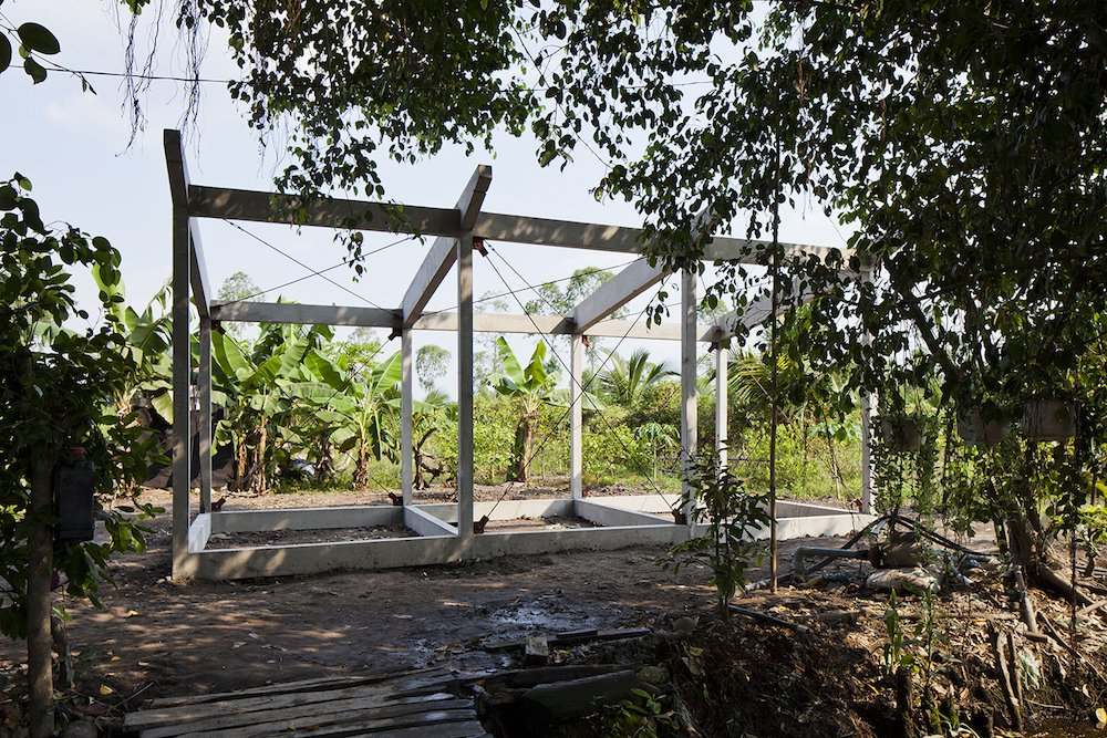 With an average income of $130 a month, residents of the Mekong Delta often create similarly sized thatched housing, but the standard timber frames warp due to flooding and weak soil. The concrete frame costs more upfront, but last much longer.