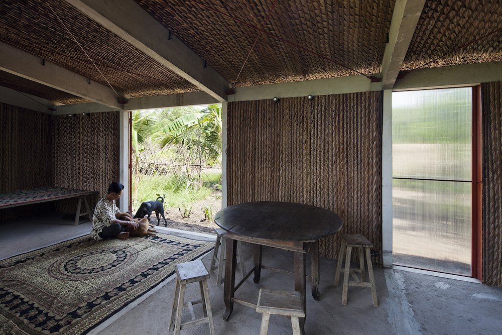 The interior construction of the S House is simple and stragithforward; ten concrete posts braced by steel supports are filled with Nipa palm panels fashioned on site.  Photo 6 of 7 in A $4000 Prefab Prototype in Vietnam