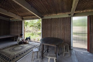 The interior construction of the S House is simple and stragithforward; ten concrete posts braced by steel supports are filled with Nipa palm panels fashioned on site.