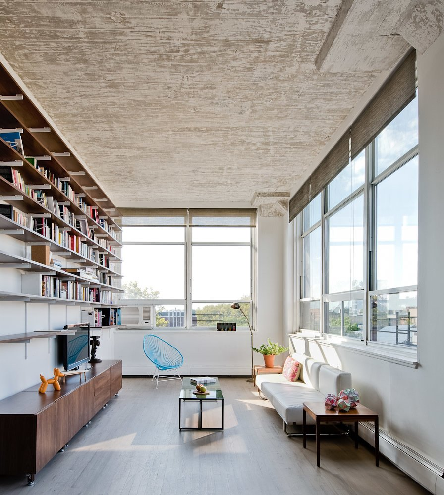 Acapulco chair living room - The Windows On The Right Look Out To Manhattan The Blue Acapulco Chair Echoes The