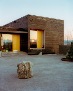 101 Best Modern Cabins - Photo 7 of 101 - The House for a Musher is all about taking advantage of its hilltop site. The courtyard in the front has vast views and the house itself is oriented toward the surrounding landscape.