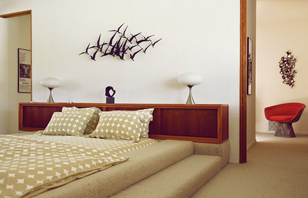 A McKenzie-designed bed and a retro wall-hanging in one of the bedrooms at Borrego Springs.
