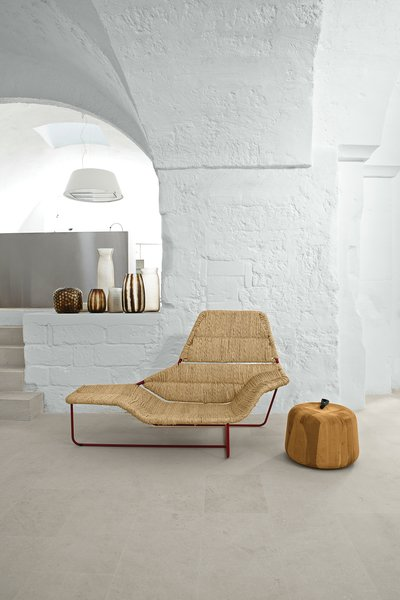 Serafini and Palomba's vacation home is a cavernous showcase for their own designs. In the living room, they created a one-off version of their Lama chaise longue, originally designed for Zanotta. The Zen Apple side table, also theirs, is from the Sen Line Collection by Exteta. The vases are by Guaxs.