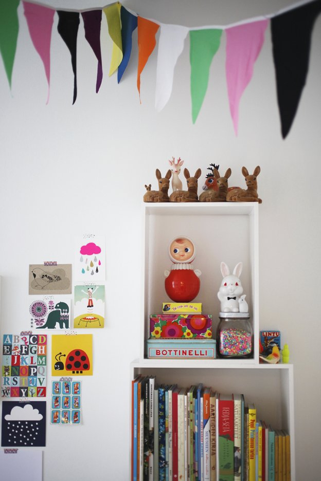 While she was pregnant and on maternity leave, Susanna tackled creative D.I.Y. projects to decorate Varpu's room, including stitching these festive cotton flag banners. Tagged: Storage Room and Shelves Storage Type.  Photo 14 of 16 in Fine Finnish