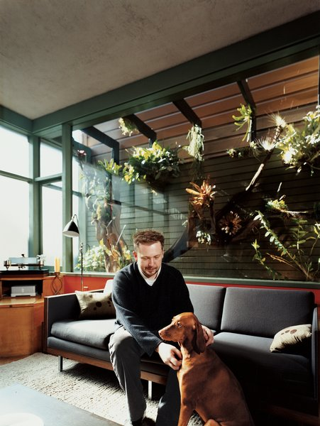 Farnham and Kasia sit in front of the home's most impressive feature: an enclosed atrium overlooking the living area. In 2007, Dale Loughins outfitted the atrium with all manner of exotic epiphytes and an automated misting system.