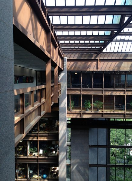 Architects Kevin Roche and John Dinkeloo designed the headquarters for the philanthropic organization the Ford Foundation with the worker in mind, inverting the layout of a typical skyscraper so that every office had exterior views or views onto an indoor park in the ten-story glass atrium.