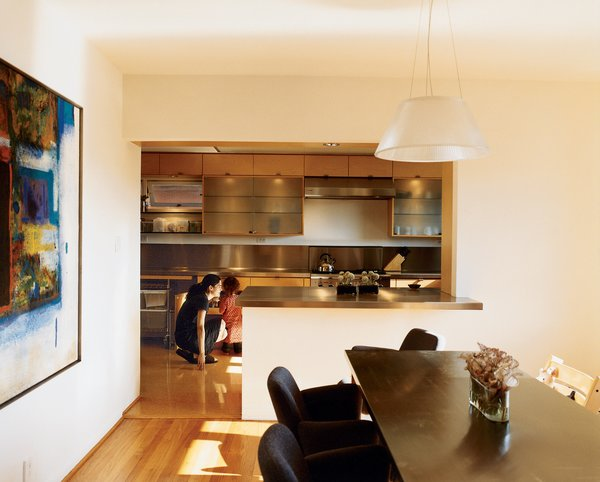 Hachigian and daughter Sosi in the renovated kitchen, which opens up to an outdoor dining terrace. The dining table was reconditioned from a language lab, its top wrapped in stainless steel. Dining chairs are by Kartell.