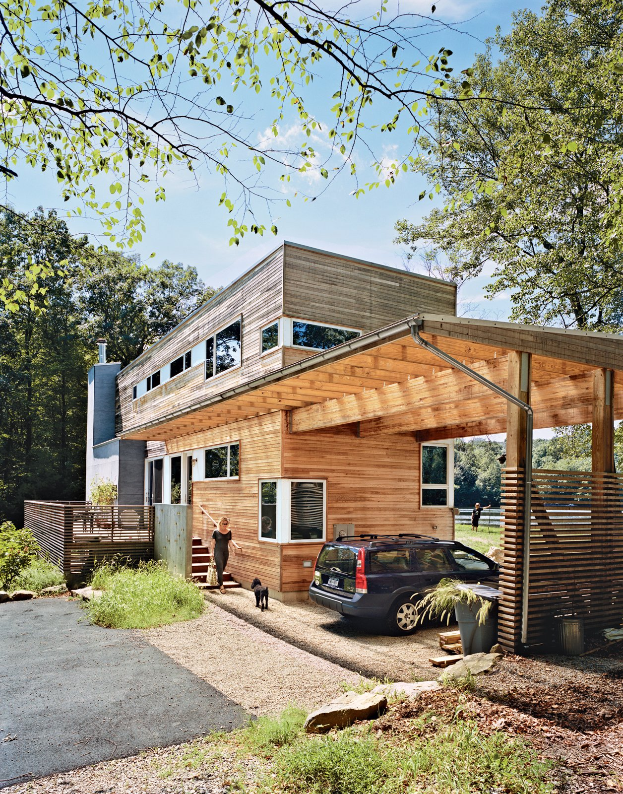 A Lakeside Prefab in New Jersey  A New Zealand expat and her son use their prefabricated lakeside New Jersey retreat as an outdoorsy counterpoint to city life.  Photo by: Mark Mahaney  Curious on what was popular last week? Click here! Tagged: Exterior, Wood Siding Material, and House.  Cabins & Hideouts by Stephen Blake from The New Zealand Native Who Can't Get Enough of the Garden State