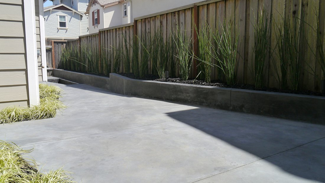 """""""I think there's plenty of missed potential in small compact spaces like these,"""" Lee says. I see it in my neighborhood and other places in publication. People tend to think a small space is a small space and don't try to do very much with it.  Concrete by Saabi Saab from A Design-Minded Solution to a Narrow Landscape"""