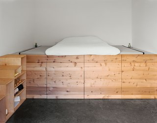 Abandoned Industrial Compound Becomes a Modern Home Base - Photo 5 of 11 - The couple's bedroom, occupying a space that was once a machine shop, has a cedar sleeping platform designed and built by Elliot Loh.