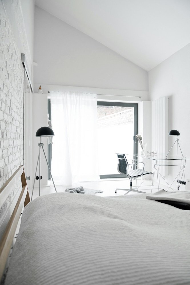 For the bedroom, the designer selected a bed by Muji and floor lamps by Lightyears.  Photo 9 of 10 in A Run-Down Farmhouse Becomes a Sleek Modern Retreat