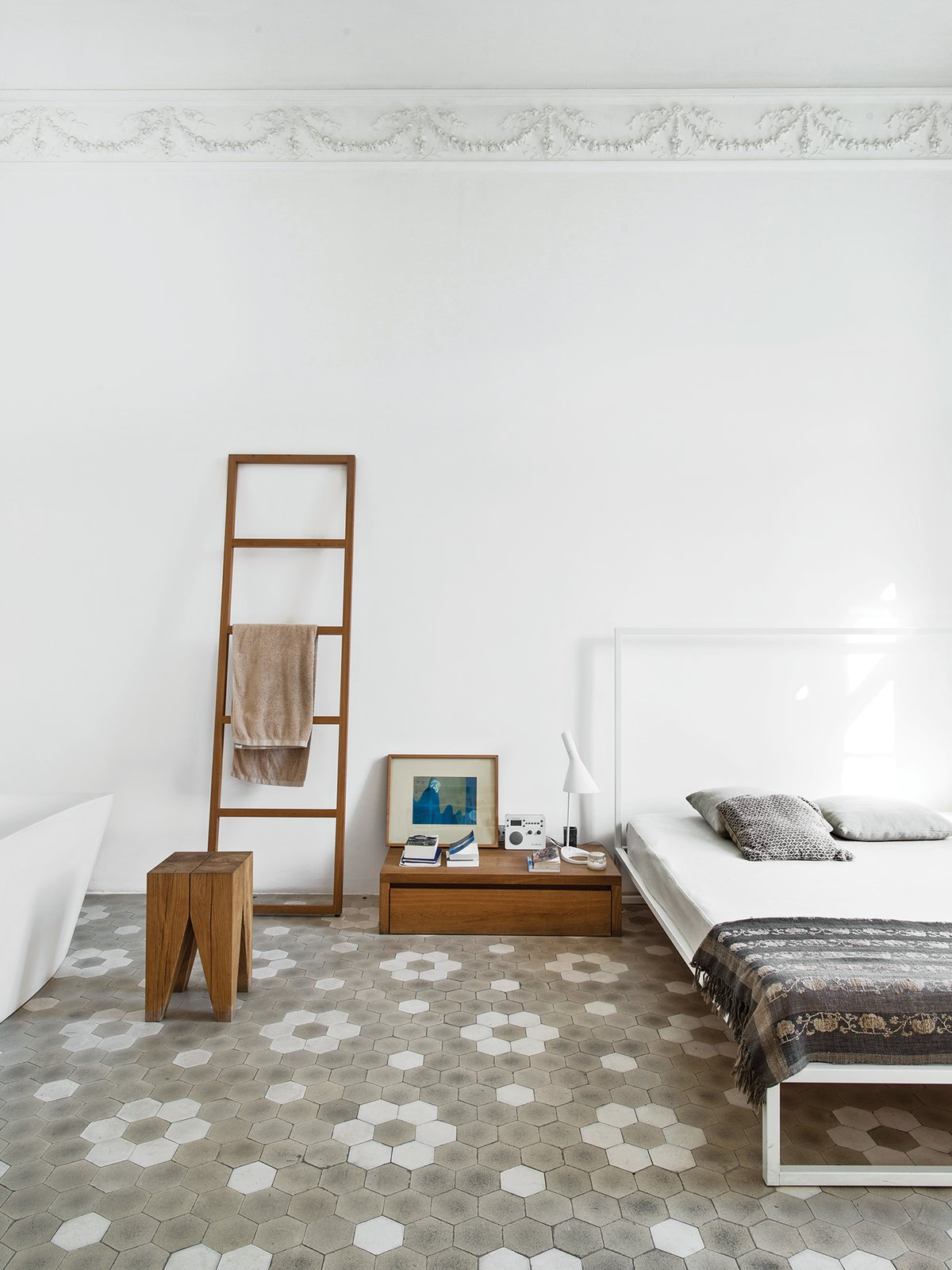 The master bedroom includes a Mini bed by Emaf Progetti for Zanotta, a tub by Sanico, and a towel rack and side table by Philipp Mainzer. Tagged: Bedroom, Bed, Night Stands, and Lamps.  Bedroom by Lauren Gundlach from Love at First Sight