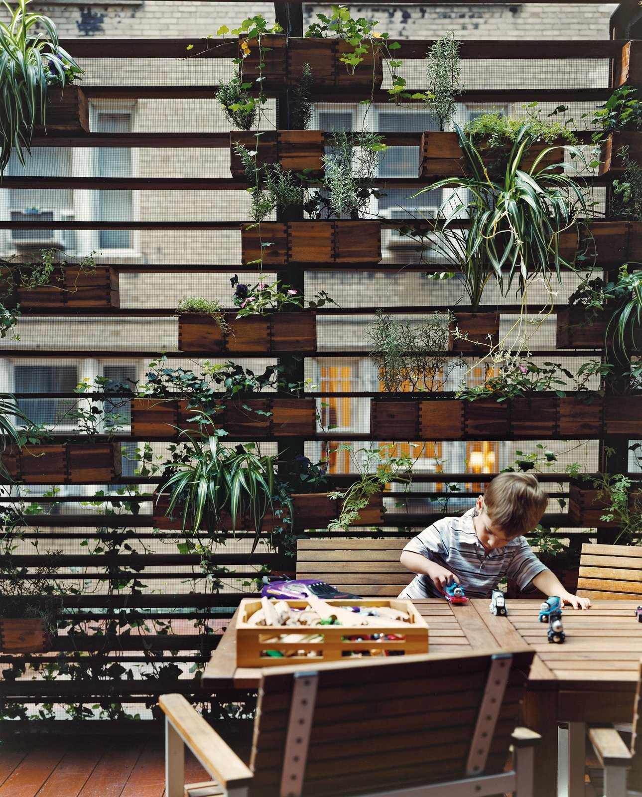 The Zizmors' son plays in front of a living wall created by urban landscaper Kari Elwell Katzander of Mingo Design.  Plants by Nikki Webster from Outdoor Living in NYC