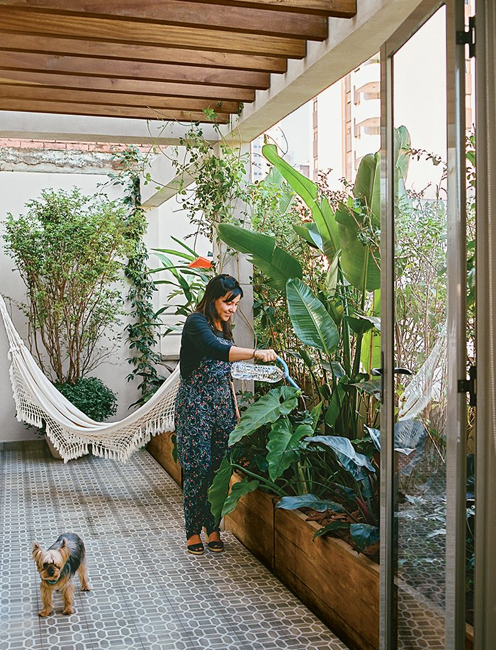 Architects Simone Carneiro and Alexandre Skaff transformed a cramped São Paulo apartment into a mid-city refuge for Simone Santos. Tagged: Outdoor, Garden, Gardens, Raised Planters, Walkways, Shrubs, Small Patio, Porch, Deck, and Tile Patio, Porch, Deck.  Photo 1 of 15 in Amazing Garden Oasis in São Paulo Born from a Five-Year Search and Renovation